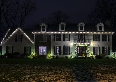 WYnantskill area home decorated for Christmas with white lights from The Christmas Guys by Elfperts Inc