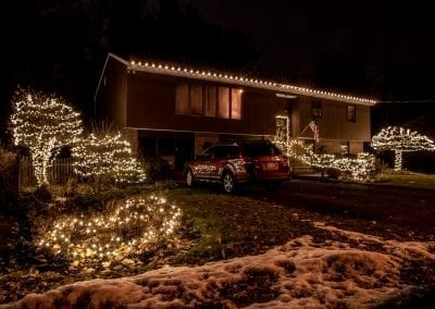 single story home decorated for Christmas
