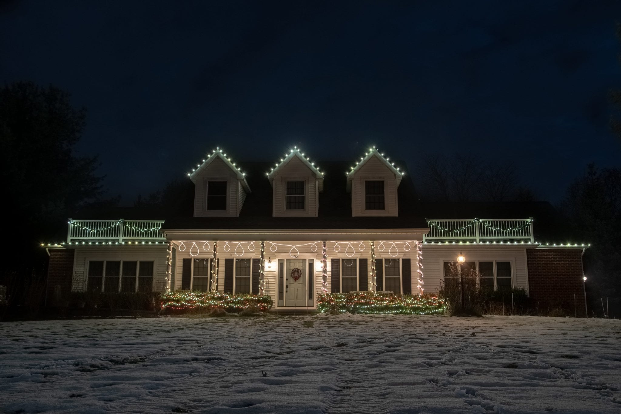 Home in Clifton Park NY decorated for Christmas with a custom made hanging motif crafted by The Christmas Guys
