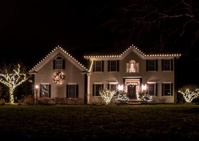 Latham NY home decorated for the holidays with thousands of white led lights
