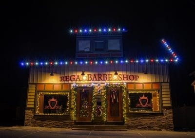 red white and blue led lights on a barber shop decorated for christmas time
