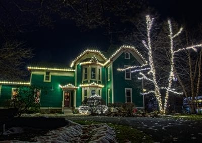 Green house in historic Saratoga decorated professionally for Christmas