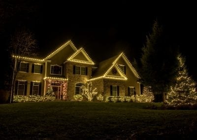White lights on a home in Latham New York decorated for Christmas