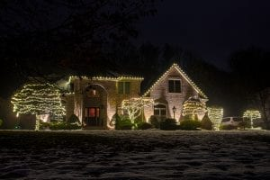 all white led lights decorating trees and roofline
