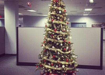 Interior Christmas tree decorating for a corporate office in CLifton Park NY