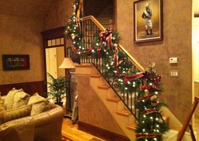 interior garland hanging on stairs in an ALbany NY home
